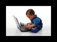 Toddler working at a laptop
