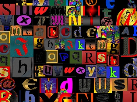 Jumble of colorful letters on black background.