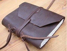 Leather portfolio with manuscript inside.