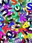 Multicolored jumbled pile of letters A-Z.