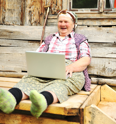 Old-peasant-woman-with-laptop.